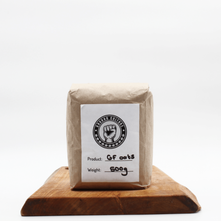 Gluten Free Oats in biodegradable packaging on a wooden board