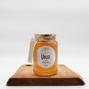 Ubusi Raw Fynbos honey on a wooden board with a white background