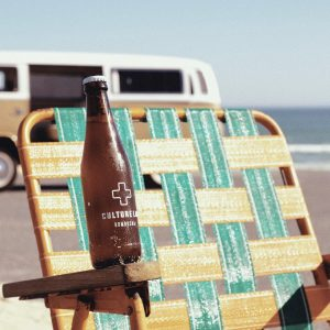 Culture Lab on beach chair with VW Van