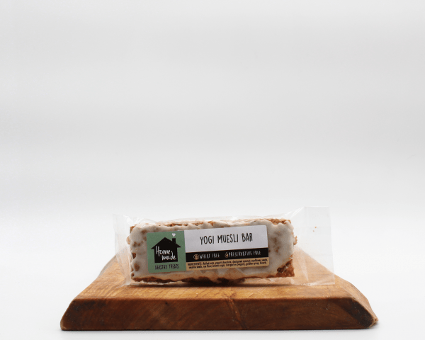 Yogurt Chocolate Muesli Crunch Bar on a wooden board with a white background