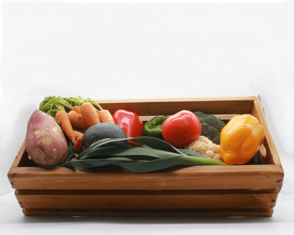Organic Harvest Veg bag in a wooden crate with a white background