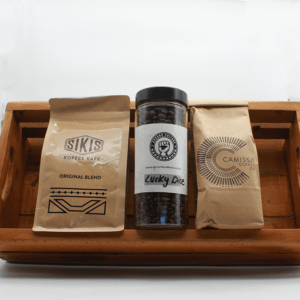 Coffee Bundle in a brown wooden basket with three different coffees with a white background