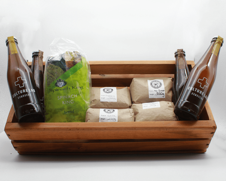 Healthy Bundle in a wooden basket with a white background