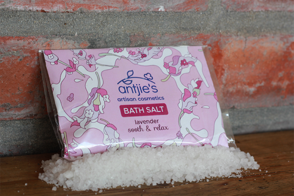 lavender bath salts sitting on a wooden table