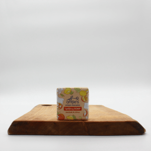 Antjies Baobab And Citrus soap in biodegradable packaging sitting on a wooden board with a white background