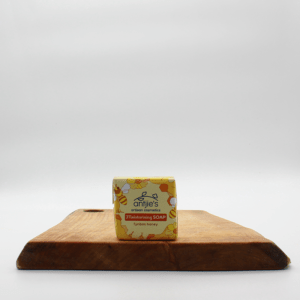 natural Fynbos Honey soap sitting on a wooden board with a white background