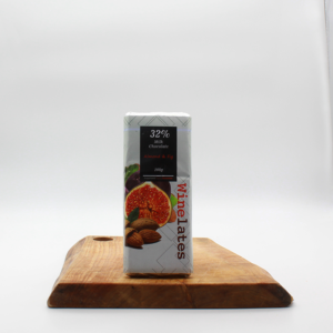 almond and fig flavoured milk chocolate made in Khayelitsha sitting on a wooden board with a white background