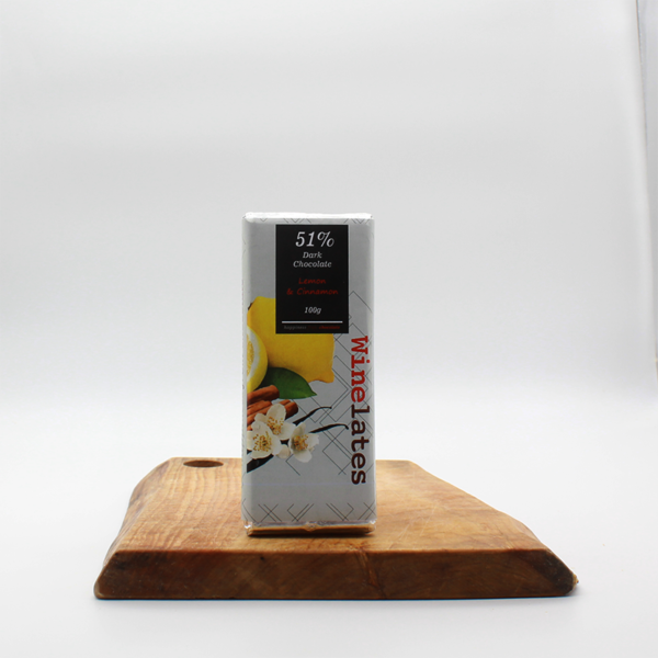 lemon and cinnamon flavoured dark chocolate from Khayelitsha sitting on a wooden board with a white background