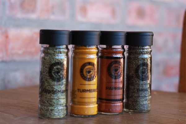 glass spice jars on a wooden table